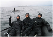 three-drysuit-divers